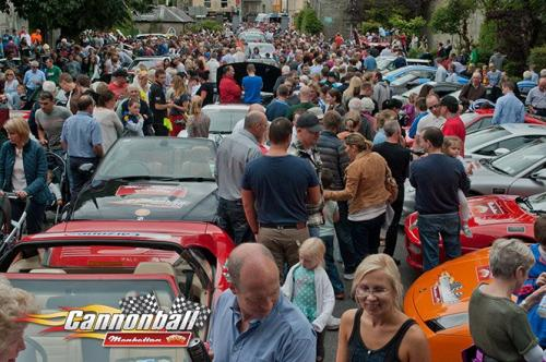 massive crowds people supercars